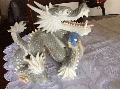 chineze dragon ornament grey & white ceramic holding blue ball