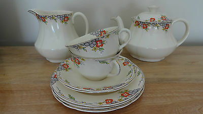 Alfred Meakin Royal Marigold teapot, jug, two trios and extras. Maybe post.