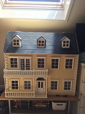large beautiful yellow wooden dolls house with furniture, tacky wax and more