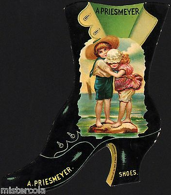Vintage trade card A PRIESMEYER SHOES die cut shoe shaped boy and girl n-mint