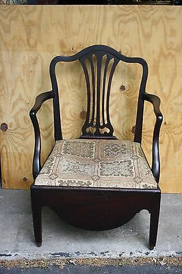 Antique Odd chair from 1730 solid wood frame with dark finish and cloth seat