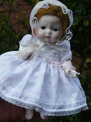 "Antique Reproduction Small doll 7.5"" Tall. Tynee."