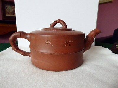 A 5 inch Yixing Teapot  Small neat repair on on the rim of the lid.