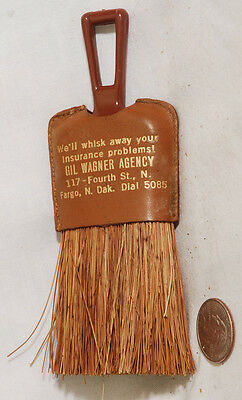 Insurance advertisement Gil Wagner Fargo N.Dakota . Whisk broom