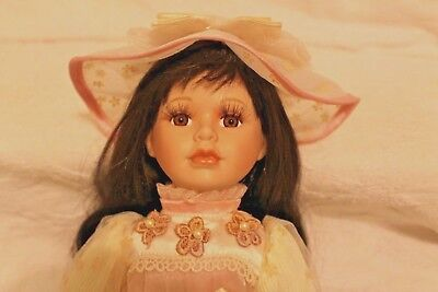"""Beautiful Brunette Porcelain Doll 16"""" in pink and cream color dress with hat"""