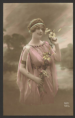Fashionably Dressed Young Lady Poses Holding a Lilly. A Pair of Tinted Postcards