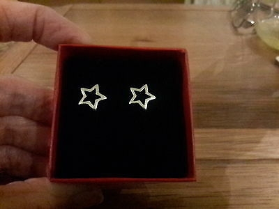 Brand new 925 stamped Silver plated tiny hollow star earrings with gift box.