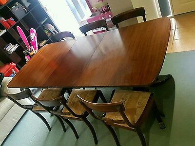 antique extendable dining table and 6 chairs.