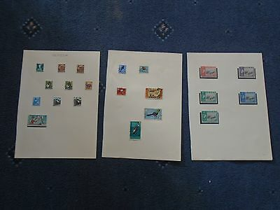 collection of stamps Uganda hinged on album pages (a)
