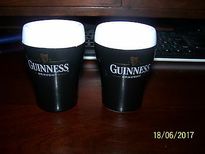 A Pair Of Guiness Egg Cups