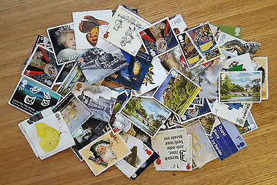 50 x 1ST FIRST CLASS UNFRANKED COMMEMORATIVE STAMPS OFF PAPER, NO GUM