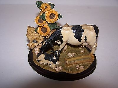 "Cow/calf Figurine on dark wood base size 5"" X 6.5 "" sunflowers/ spotted cow/calf"