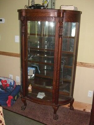 Old Tiger Oak Lions Head Bow Front Curio Cabinet