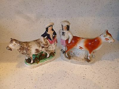 Pair Of 19C Staffordshire Pottery Cow Creamer Figures