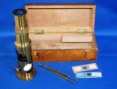 A super antique brass bodied drum type microscope with box and tweezers