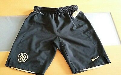 Boys Nike shorts,  size M/age 10-12yrs, black with gold detail.