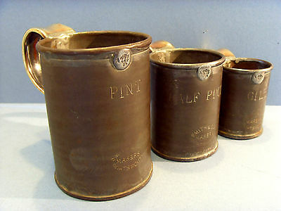 SET OF THREE GEORGE IV TIN / BRASS TANKARDS WITH CROWN LEAD SEALS , c 1820-30.