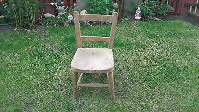 very small childs old wooden school chair.
