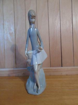 Nao figure of girl with bird FREE UK P & P