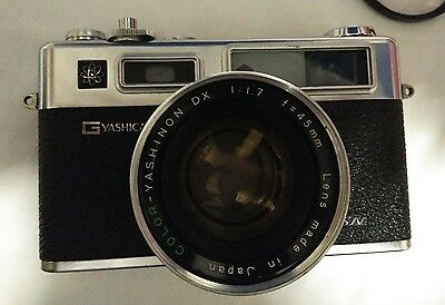 Camera Yashica GSN Electro 35 SLR film camera with 45mm lens and battery