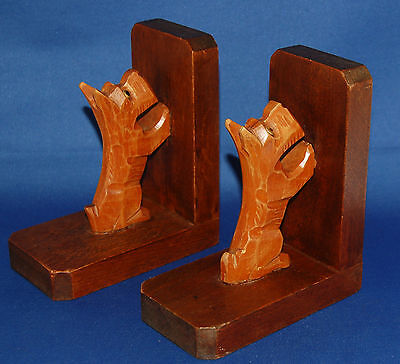 A characterful pair of Edwardian to 1930's Scottie dog bookends with glass eyes
