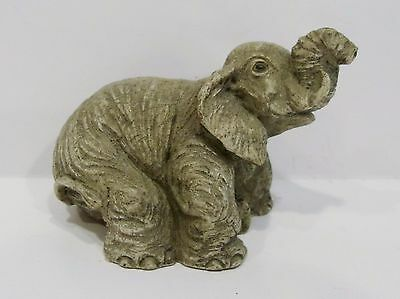 little ceramic elephant figurine