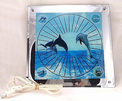 Dolphin Wall Light Mirror with a Multi Colored Kaleidoscope Effect