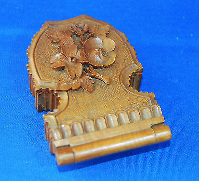 A beautiful hand carved wooden continental lined pocket watch stand, floral dec