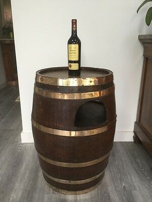 Antique oak and brass barrel drinks cabinet