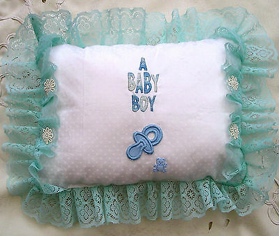 A hand made New Baby Boy Cushion, whitge and turquoise, hand embroidered, unique