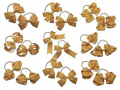 Girls gold hair bows on thin bobbles, gold toddler hair accessories, hair clips