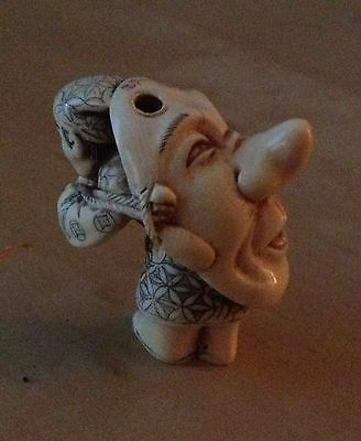 Antique Netsuke Hand Carved Man carrying Festival Tengu Mask
