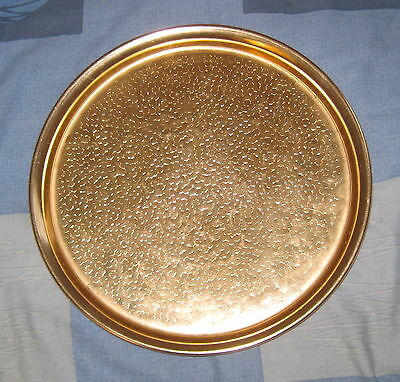 Copper over metal plate serving decorative plate used