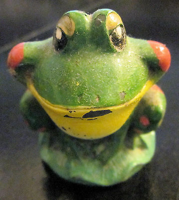 Small ceramic figurine of a seated frog