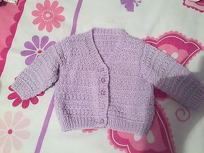 hand knitted baby cardigan In Lilac