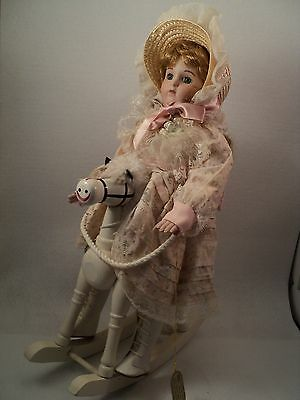 "16"" porcelain and cloth Wimbledon doll on white wooden rocking horse"