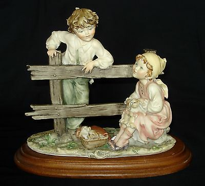 Vintage Capodimonte Girl And Boy With Three Puppies Signed B Merli 1983