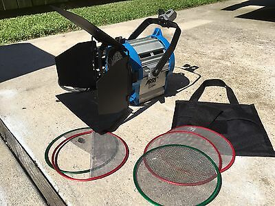 Arri 650W Fresnel with barn doors and scrim set.