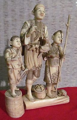 hand carved ivory colored figures, signed