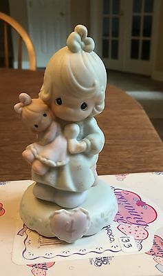 "Precious Moments Growing in Grace AGE 4 ""Girl with Doll"" (model #136239)"