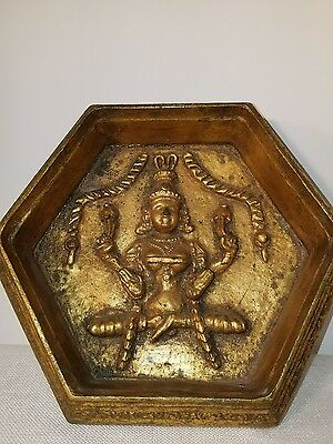 6 sided wooden box .Hindu statue on bottom inside box. Gold tone.