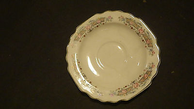 Probably antique Lido W. S. George flowers and white saucer
