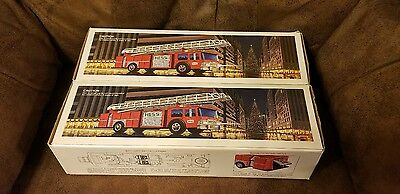 Two (2) New 1986 Hess Trucks - Gold and Silver Bumpers