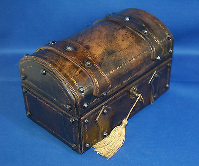 An antique leather covered medieval, treasure chest style jewellery casket