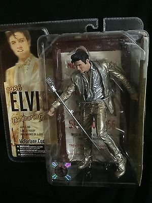 Elvis Presley figure on stand collectable  (1956 The Year in Gold)