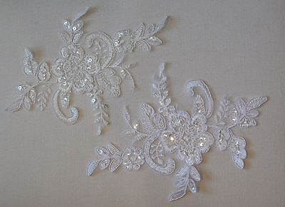 A white or ivory sequined lace applique / tulle sequins lace motif sold by piece