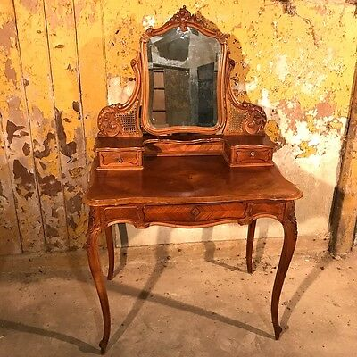 Antique French walnut dressing table with cane panels