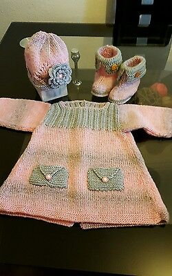 Hand knitted baby dress  -  baby knits