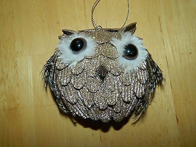 metallic colored owl ornament made out of foam and feathers
