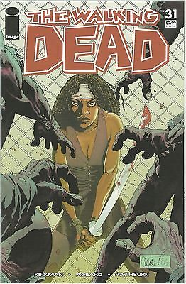 The Walking Dead #31 1st Printing NM+ Michonne Pressable to 9.8